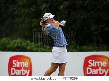 KUALA LUMPUR, MALAYSIA - OCTOBER 11, 2014: Austin Ernst of the USA tees off at the fourth hole of the KL Golf & Country Club during the 2014 Sime Darby LPGA Malaysia golf tournament.