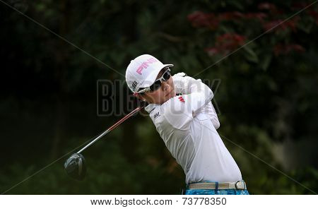KUALA LUMPUR, MALAYSIA - OCTOBER 11, 2014: Ayako Uehara of Japan tees off at the fourth hole of the KL Golf & Country Club during the 2014 Sime Darby LPGA Malaysia golf tournament.