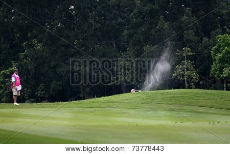 KUALA LUMPUR, MALAYSIA - OCTOBER 11, 2014: Jenny Shin of the USA makes a shot from the bunker of the ninth hole of the KL Golf & Country Club during the 2014 Sime Darby LPGA Malaysia golf tournament.