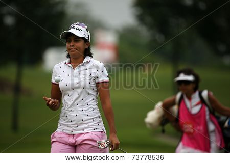 KUALA LUMPUR, MALAYSIA - OCTOBER 11, 2014: Julieta Granada of Paraguay reacts after her put at the third hole of the KL Golf & Country Club during the 2014 Sime Darby LPGA Malaysia got tournament.