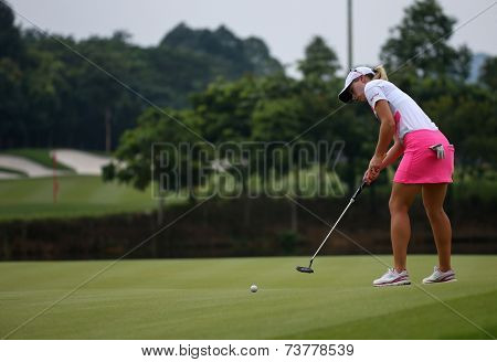KUALA LUMPUR, MALAYSIA - OCTOBER 11, 2014: Jodie Ewart Shadoff of England putts on the green of the ninth hole of the KLGC Club during the 2014 Sime Darby LPGA Malaysia golf tournament.
