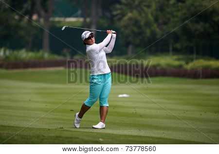KUALA LUMPUR, MALAYSIA - OCTOBER 10, 2014: Amy Yang of South Korea plays on the fairway of the ninth hole of the KL Golf & Country Club at the 2014 Sime Darby LPGA Malaysia golf tournament.