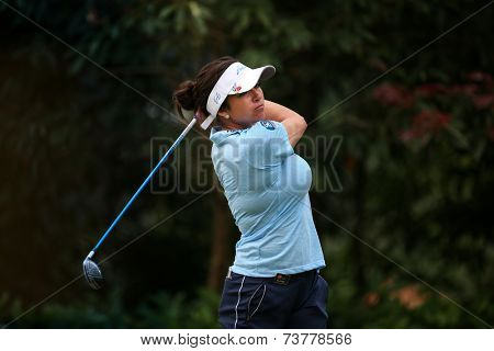 KUALA LUMPUR, MALAYSIA - OCTOBER 11, 2014: Gerina Piller of the USA tees off at the fourth hole of the KL Golf & Country Club during the 2014 Sime Darby LPGA Malaysia golf tournament.