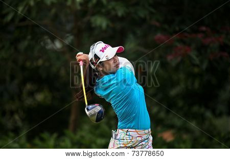 KUALA LUMPUR, MALAYSIA - OCTOBER 11, 2014: Pornanong Phatlum of Thailand tees off at the fourth hole of the KL Golf & Country Club during the 2014 Sime Darby LPGA Malaysia golf tournament.