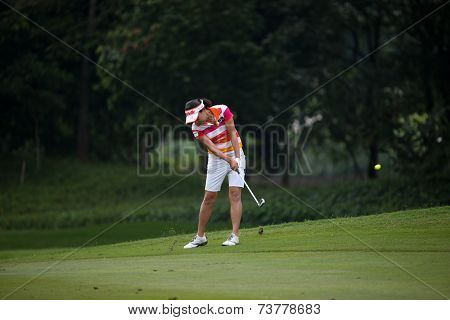 KUALA LUMPUR, MALAYSIA - OCTOBER 11, 2014: Il Hee Lee of South Korea makes a shot to the green of the ninth hole of the KL Golf & Country Club during the 2014 Sime Darby LPGA Malaysia golf tournament.