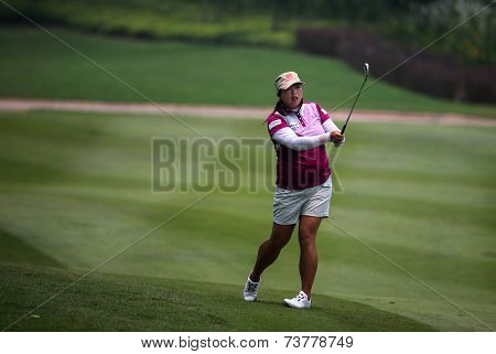 KUALA LUMPUR, MALAYSIA - OCTOBER 10, 2014: Shanshan Feng of China plays on the fairway of the ninth hole of the KL Golf & Country Club at the 2014 Sime Darby LPGA Malaysia golf tournament.