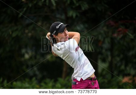 KUALA LUMPUR, MALAYSIA - OCTOBER 11, 2014: Carlota Ciganda of Spain tees off at the fourth hole of the KL Golf & Country Club during the 2014 Sime Darby LPGA Malaysia golf tournament.