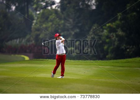 KUALA LUMPUR, MALAYSIA - OCTOBER 10, 2014: Eun-Hee Ji of South Korea plays on the fairway of the ninth hole of the KL Golf & Country Club at the 2014 Sime Darby LPGA Malaysia golf tournament.