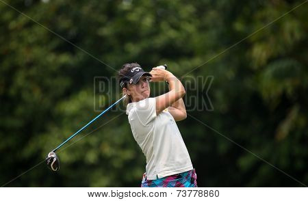 KUALA LUMPUR, MALAYSIA - OCTOBER 10, 2014: Kim Kaufman of the USA tees of at the sixth hole of the KL Golf & Country Club at the 2014 Sime Darby LPGA Malaysia golf tournament.