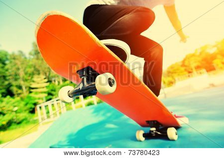 young woman skateboarder skateboarding at  modern skatepark