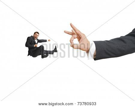 concept photo of conflict between subordinate and boss. angry screaming businessman kicking and flying at big flick of his boss. isolated on white background