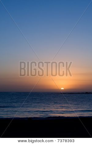 Glorious Partial Sunrise Over Ocean And Beach, Vertical