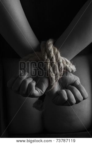 Nude submissive handcuffed woman
