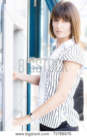Beautiful  Woman At The Atm