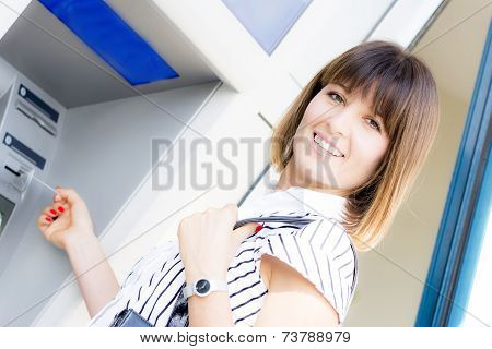 Beautiful Happy Woman At The Atm