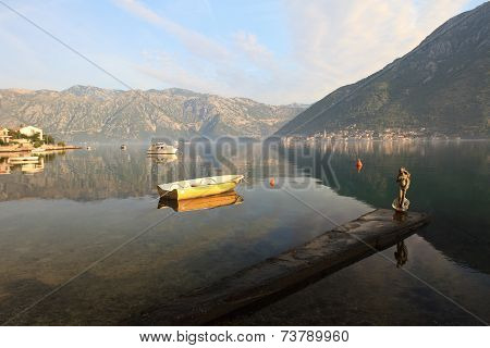 Boat And The Figurine Of Aphrodite On The Pier. Montenegro