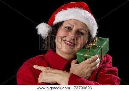 Smiling Female Senior With Red Santa Claus Cap.