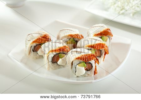 Roll made of Fresh Salmon, Smoked Eel, Cream Cheese and Avocado inside. Smoked Eel outside