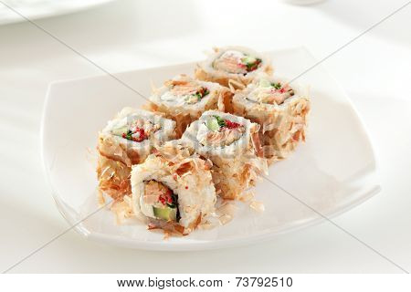 Bonito Maki Sushi - Rolls with Fried Salmon, Cucumber, Cream Cheese and Tobiko inside. Dried Shaved Bonito outside