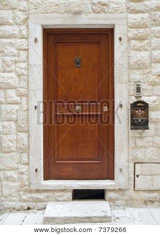 Frontdoor with post box.