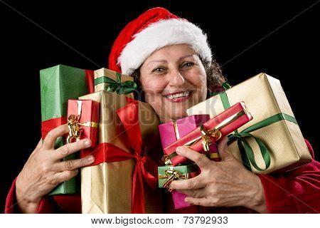 Joyful Senior Woman Hugging Eight Wrapped Gifts.