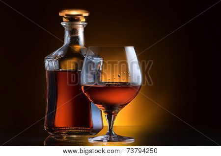 Cognac or brandy on a black