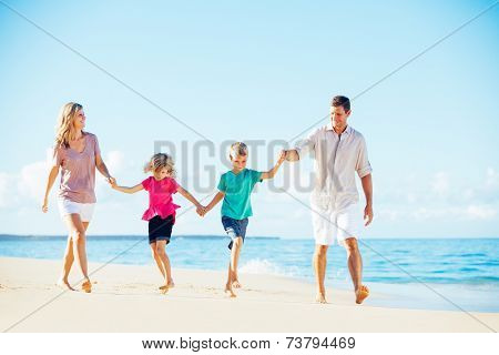 Photo of Happy Family Walking Down the Beach. Summer Lifestyle.