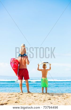 Father and Young Sons Going Surfing at the Beach, Looking out at the Ocean Checking the Waves