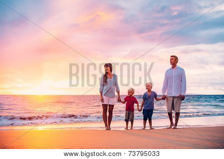 Happy Family of Four on the Beach at Sunset
