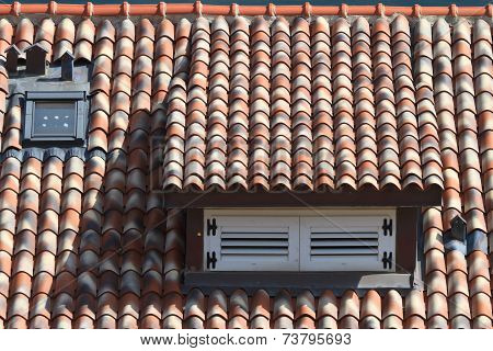 Dormer Window Shuttered In A Tile Roof, Horizontal