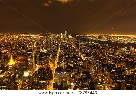 aerial view of NYC with skyscrapers at night