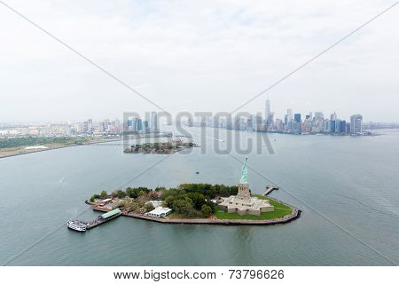 aerial view of NYC. Statue of Liberty with Manhattan skyline