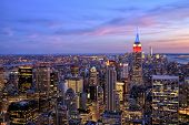stock photo of empire state building  - New York City Midtown With Empire State Building At Dusk - JPG