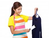 picture of knitwear  - Housewife use dust roller romover on knitwear - JPG