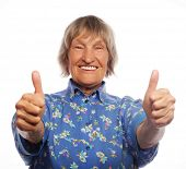 picture of 70-year-old  - Old happy woman showing ok sign on a white background - JPG