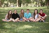 pic of bff  - Row of six male and female teens sitting outside - JPG
