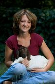 Happy Young Woman With Baby Goat poster