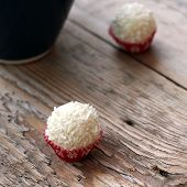 picture of bonbon  - Coconut bonbon lying on a wooden table - JPG
