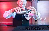 pic of bartender  - Bartender is making cocktail at bar counter