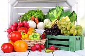 picture of wooden crate  - Vegetables in crate and in basket on white wooden box background - JPG