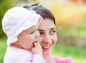 image of teething baby  - Portrait of an adorable baby with her mother - JPG