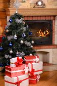 picture of cozy hearth  - Christmas tree and boxes with gifts for family fireplace background - JPG