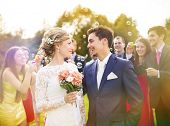 pic of blowing  - Young newlyweds enjoying romantic moment together at wedding reception outside - JPG