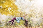 foto of levitation  - Levitation portrait of young woman in the forest - JPG