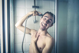 foto of douche  - Happy man in the shower  - JPG