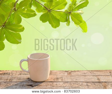 White Coffee Cup On Wooden Table At Morning Sunlight