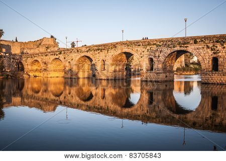 Roman bridge of Merida, UNESCO site, sunset and reflections in the river