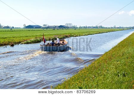 Typical blue motor boat  in the Rural countryside  Netherlands