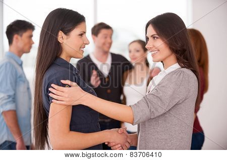 Women Handshaking.