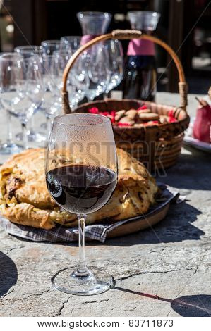 Glass Of Red Wine With Food On Table